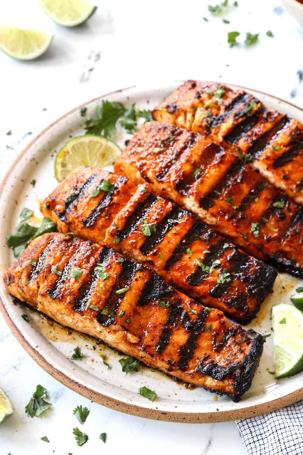 grilled salmon recipe on a plate showing how juicy it is