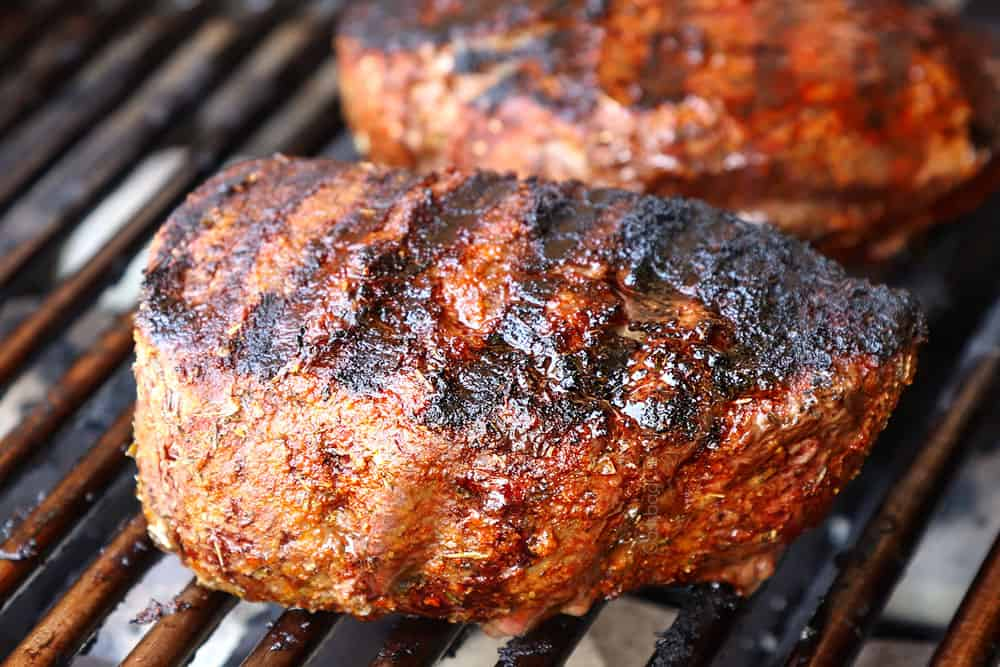 showing how to grill steak by grilling steak on a grill until seared