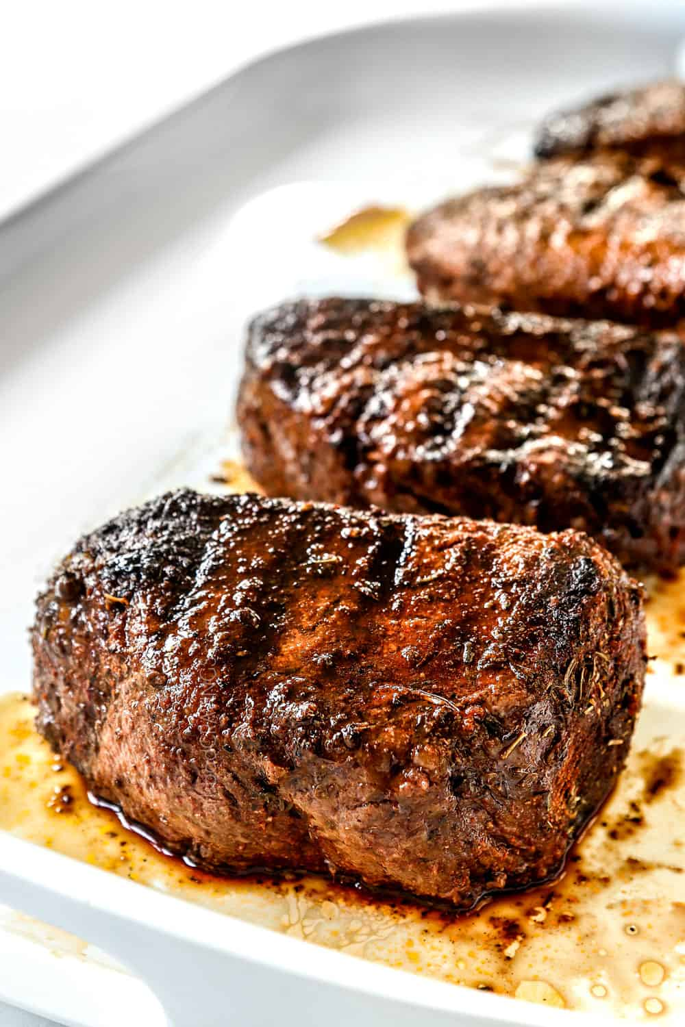 up close side view of grilled sirloin steak showing how juicy it is