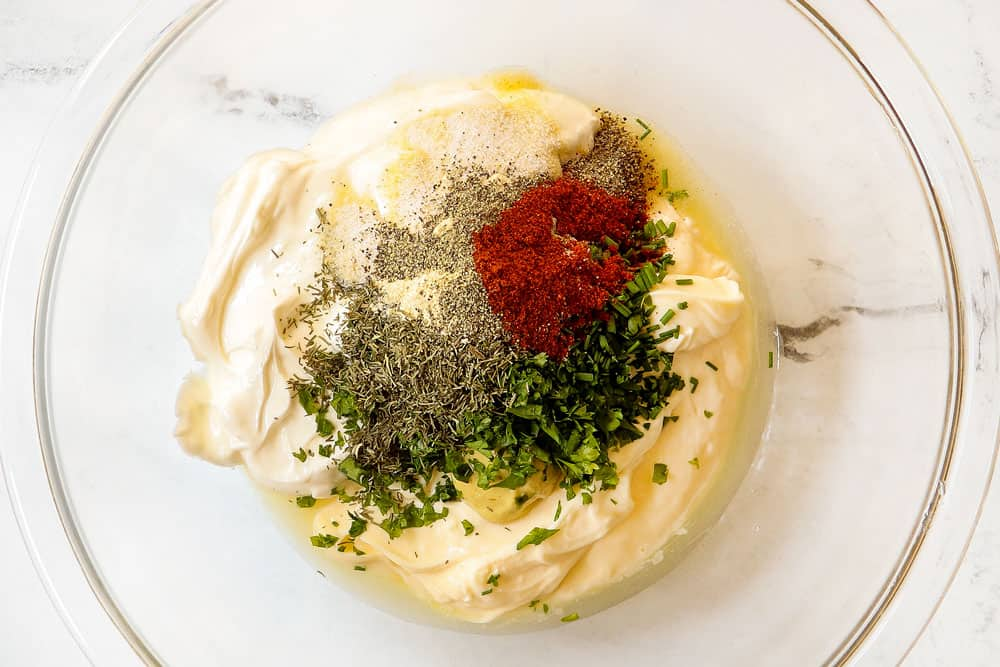 showing how to make potato salad by adding mayonnaise, sour cream, dill, parsley and chives