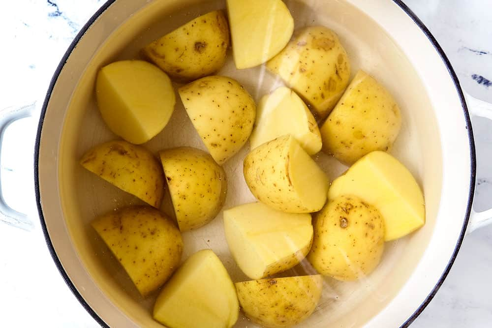 showing how to make potato salad by boiling Yukon potatoes with the skin on