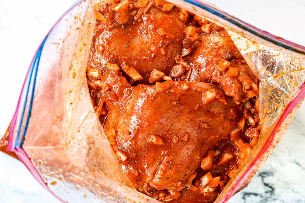 showing how to make pollo asado recipe by adding chicken to he marinade in a plastic bag