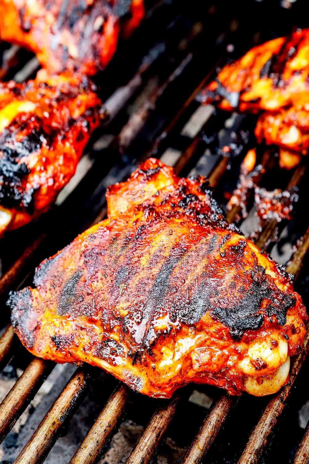 showing how to make pollo asado recipe by grilling chicken