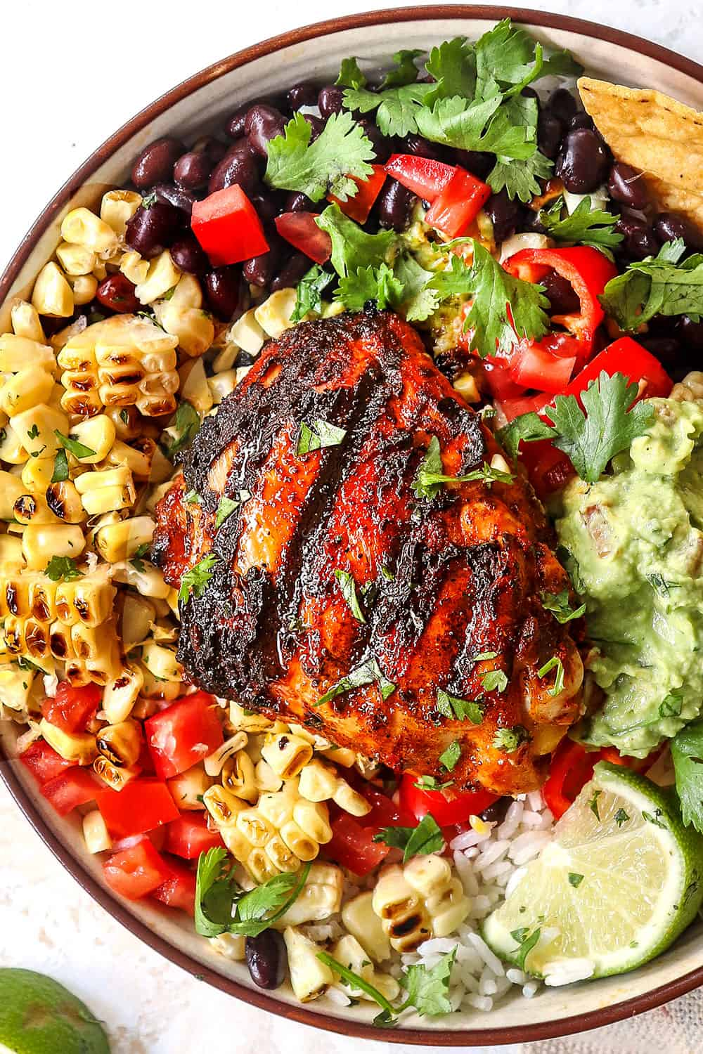 top view of pollo asado with rice, beans and corn showing what to serve with pollo asado