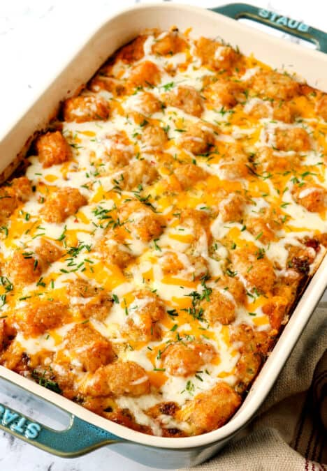 tater tot breakfast casserole covered with cheese and crispy tater tots