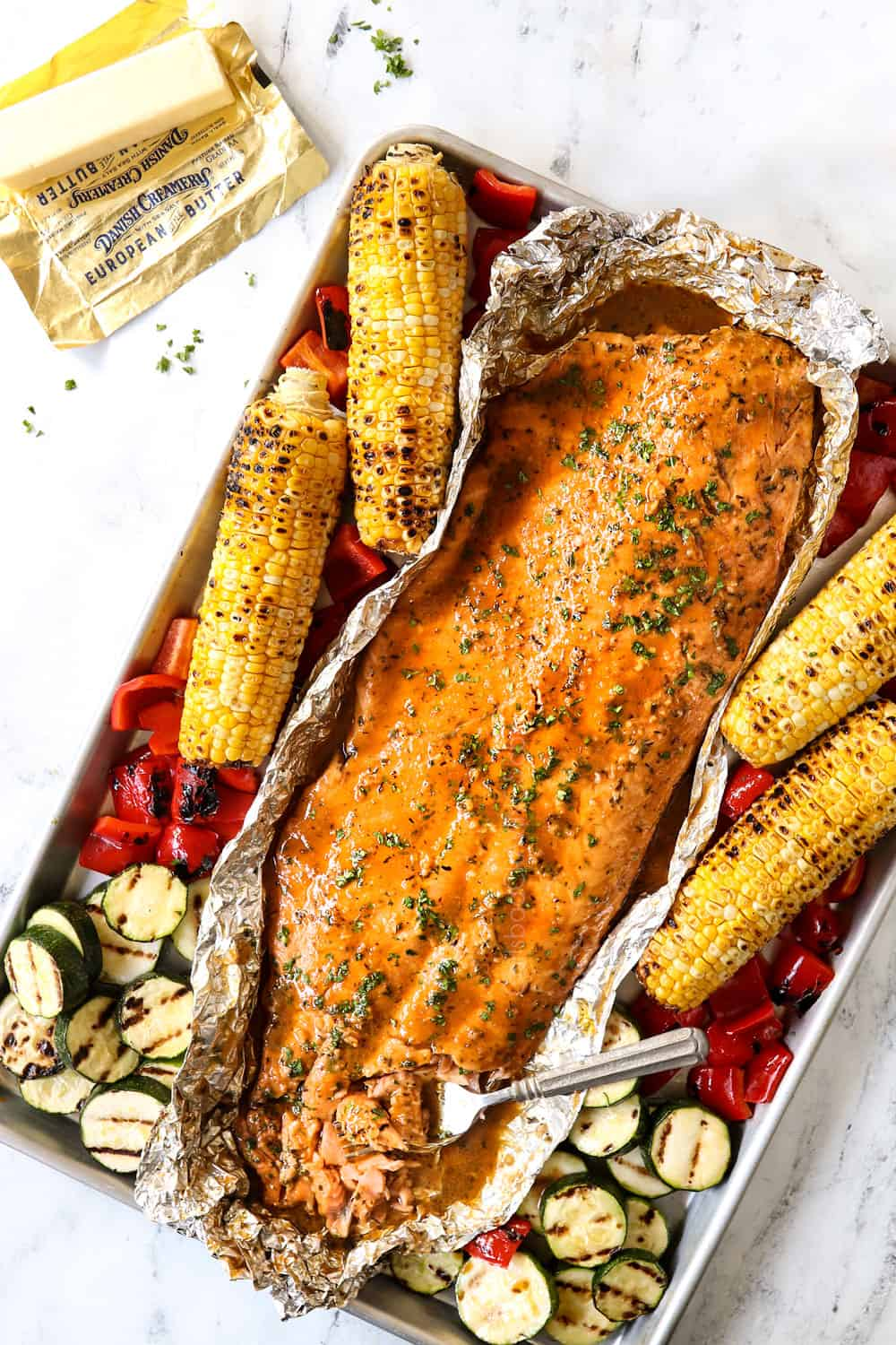 showing how to make grilled salmon in foil by letting the salmon rest after grilling