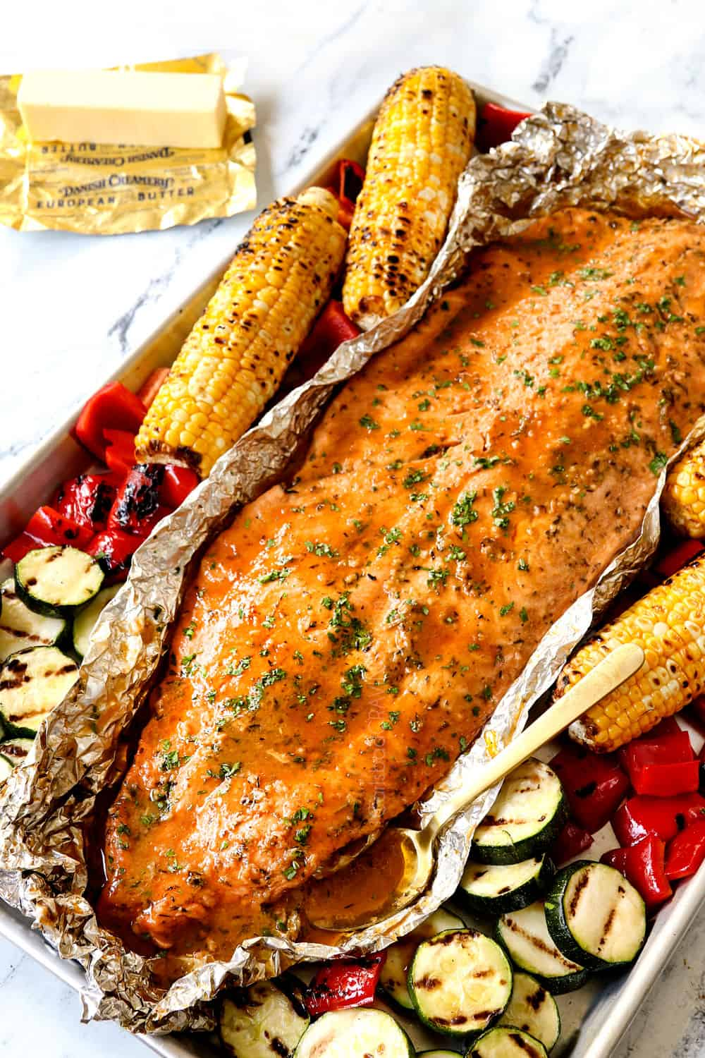grilled salmon in tin foil with grilled zucchini and grilled bell peppers