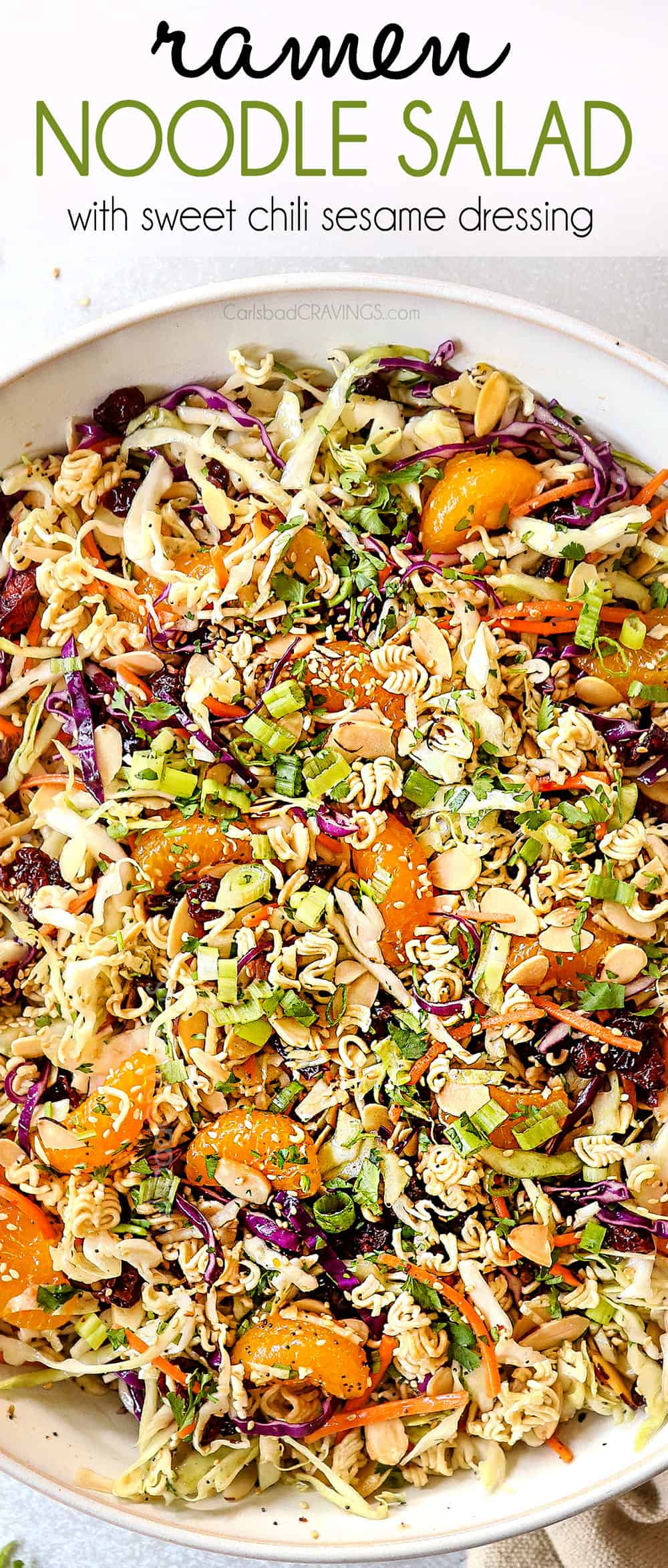 top view showing how to make Asian Ramen Noodle Salad by tossing the ingredients together with the dressing in a white bowl