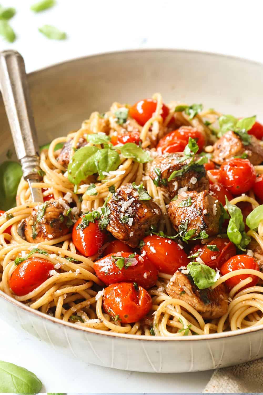 up close of bruschetta chicken pasta in a bowl