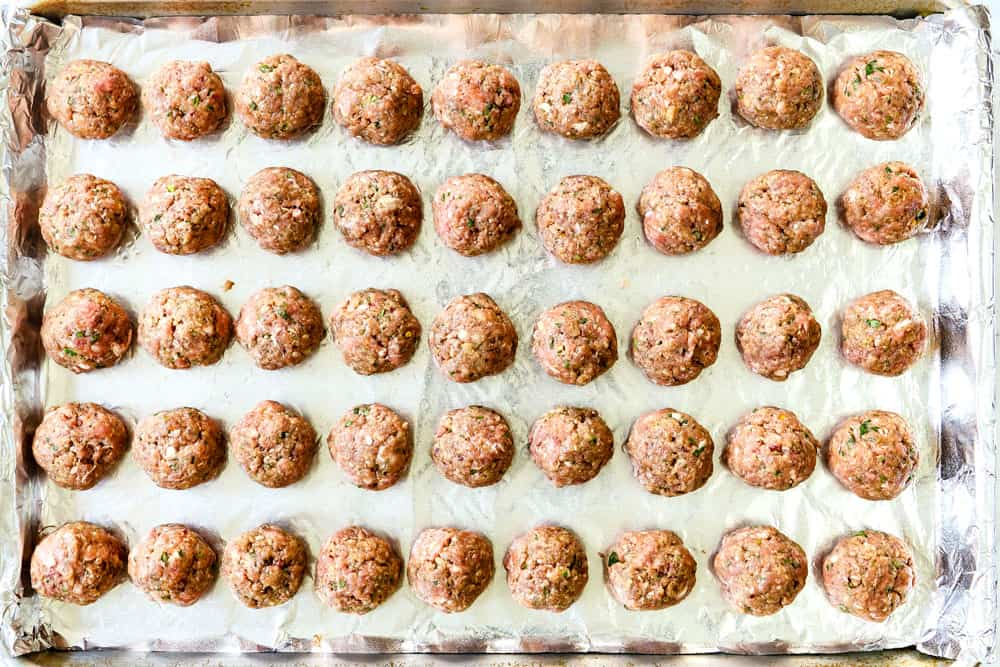 showing how to make Greek Meatball recipe (Keftedes) with lamb by rolling meatball and placing them on a baking sheet