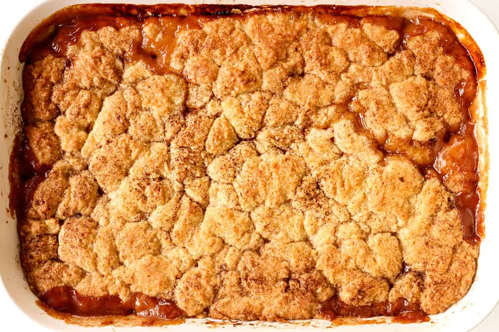 showing how to make peach cobbler by baking homemade peach cobbler until the topping is golden