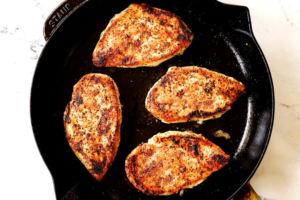 showing how to make chicken Caprese recipe by cooking chicken in a skillet until golden