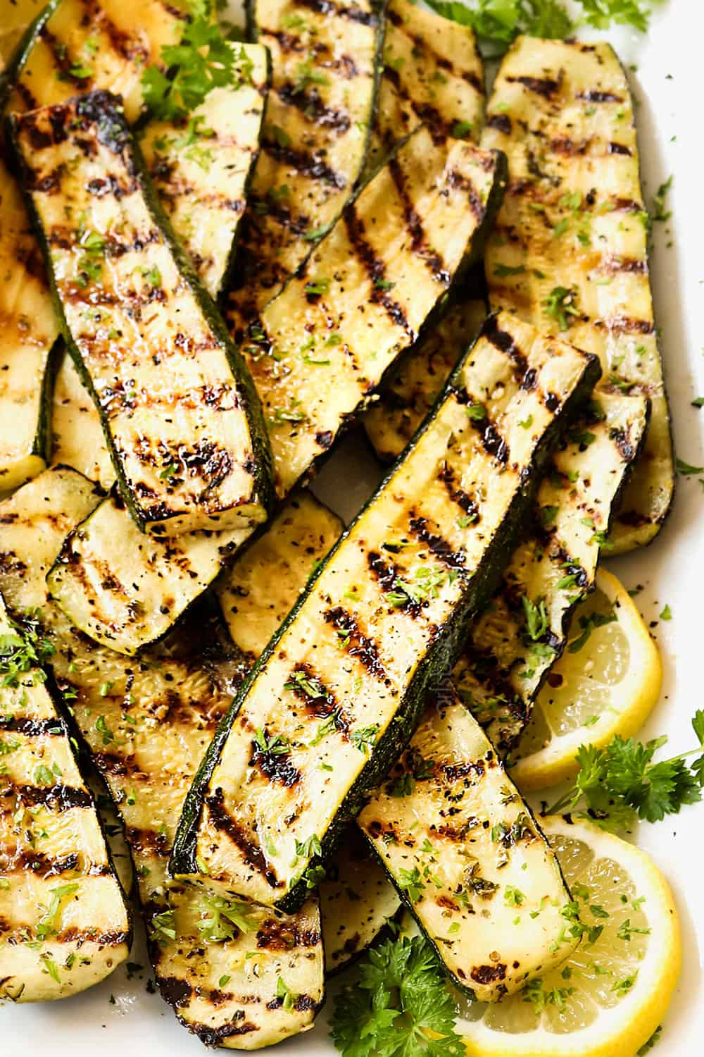up close of grilled zucchini recipe showing distinct grill marks and how thick the zucchini is