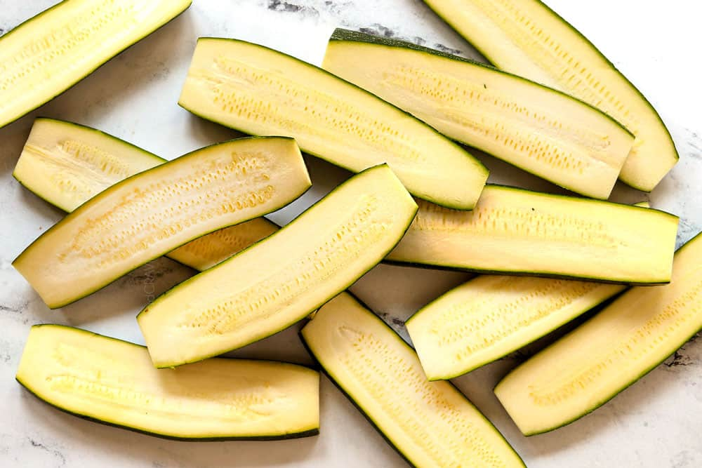 showing how to grill zucchini by slicing it lengthwise into planks