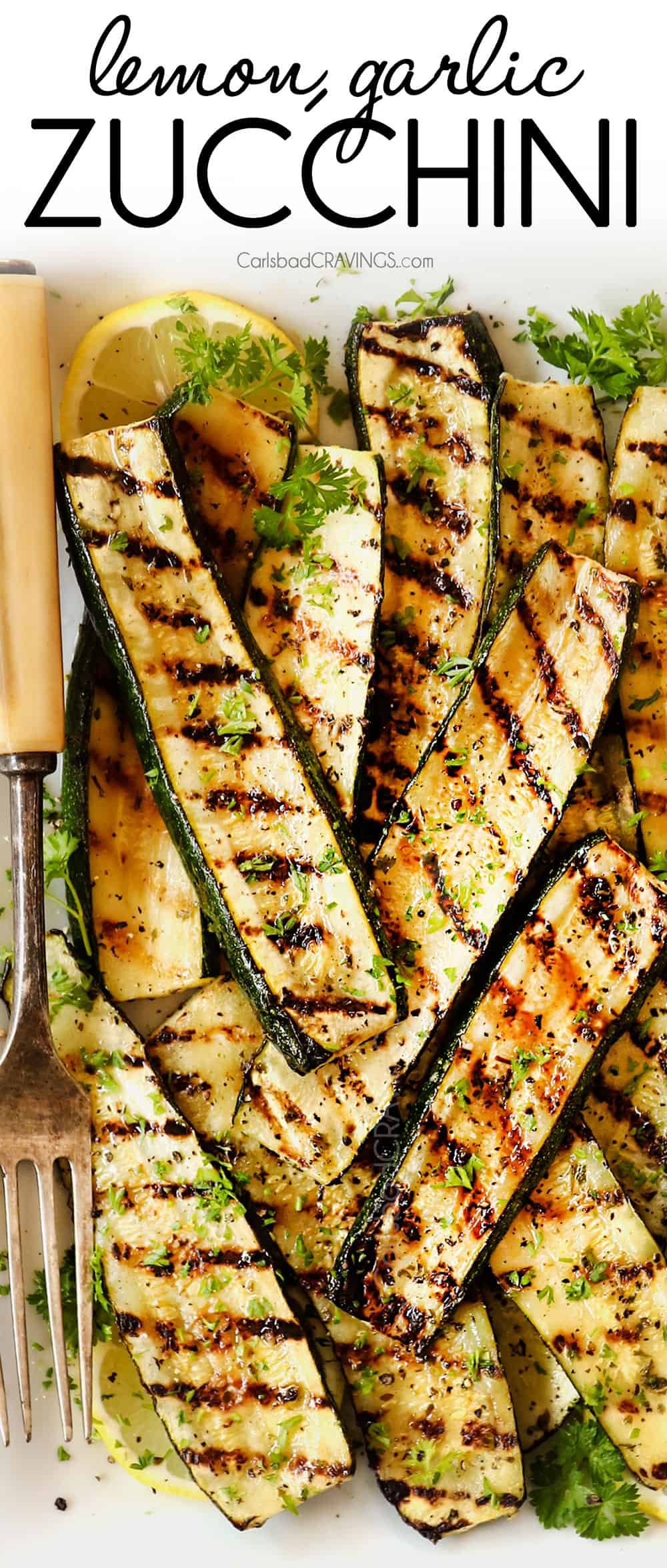 top view of grilled zucchini on a white platter