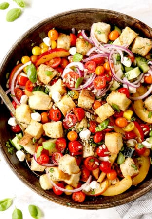 top view of Panzanella in a wood bowl with tomatoes, bread and onions