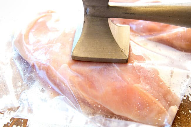 showing how to make chicken Caprese recipe by pounding chicken to an even thickness with a meat mallet