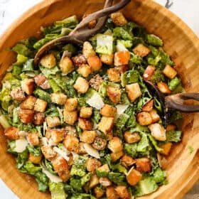 top view of Caesar Dressing recipe with Romaine lettuce, Parmesan, croutons and Caesar Dressing