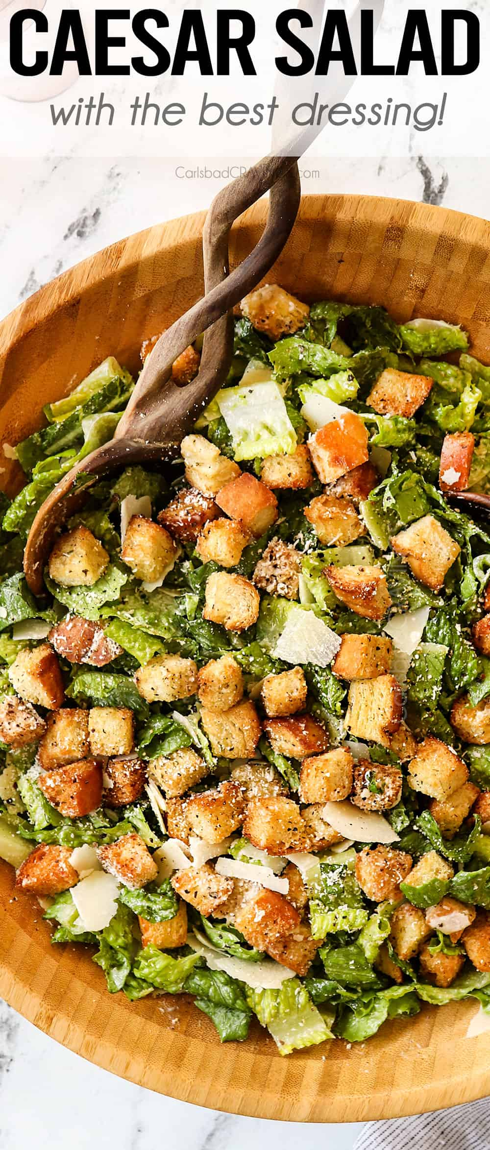 top view of Caesar Salad in a wooden bowl