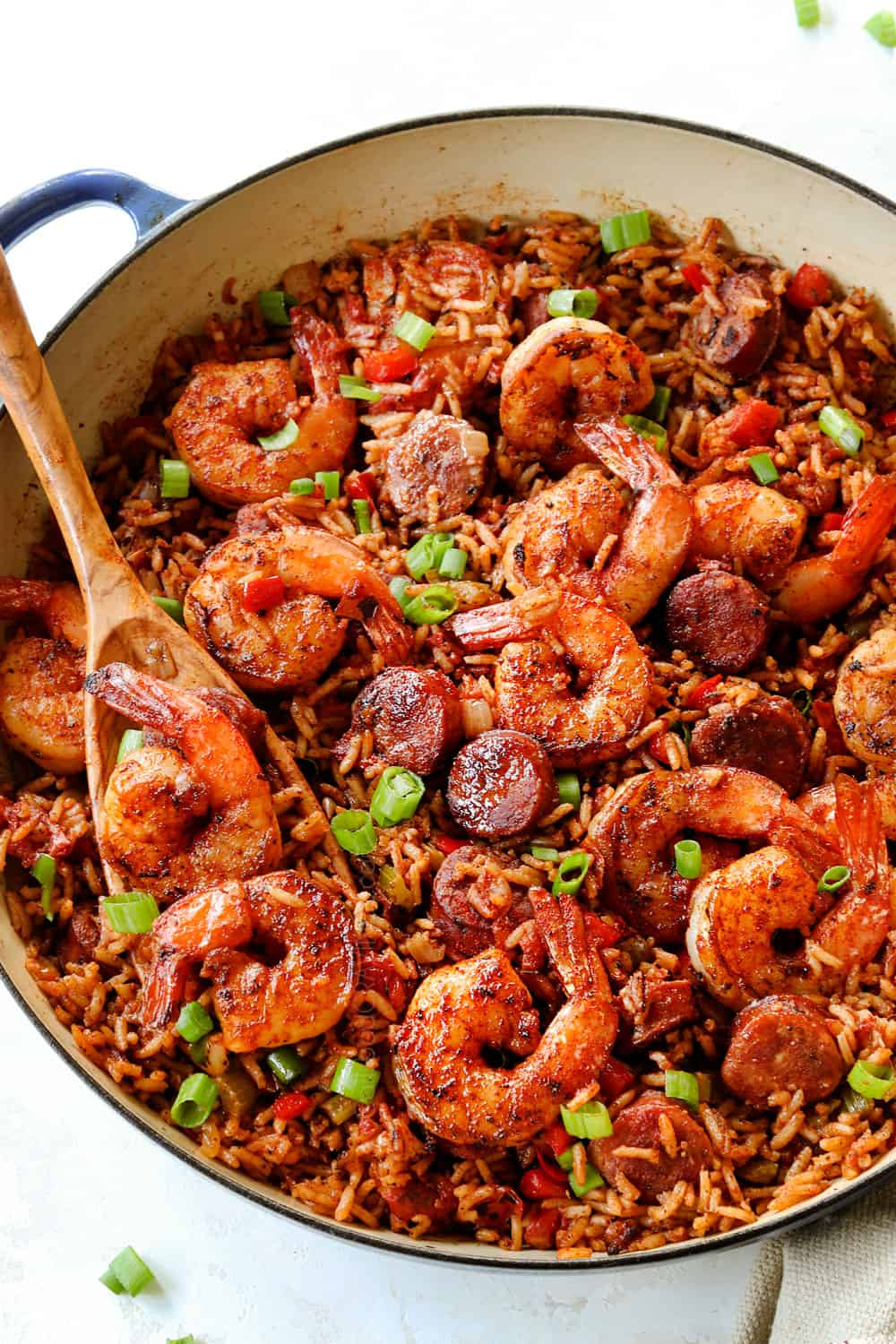 a skillet of Cajun shrimp with rice, sausage, onions, bell peppers and celery