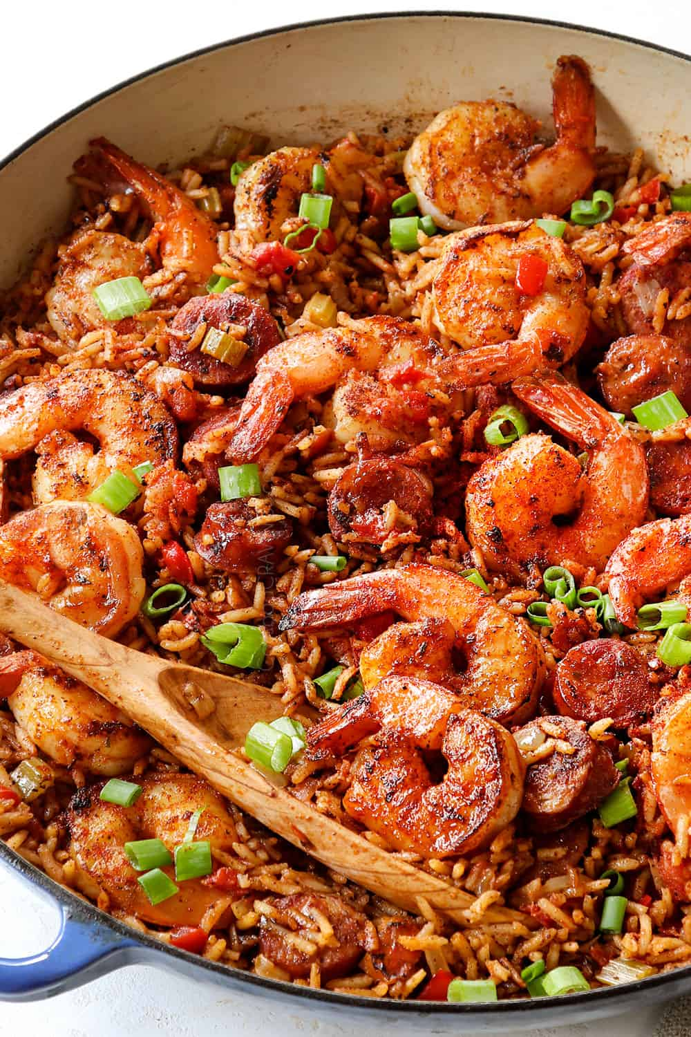 showing how to make Cajun shrimp with rice by combing shrimp with rice in a pot