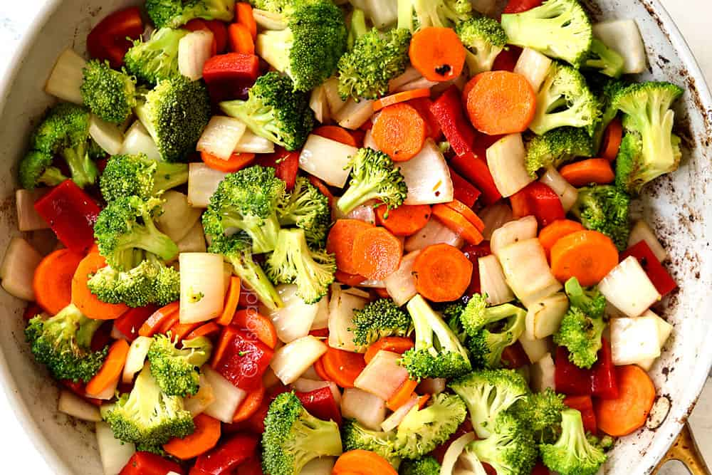 showing how to make honey garlic chicken recipe by stir frying vegetables in a skillet