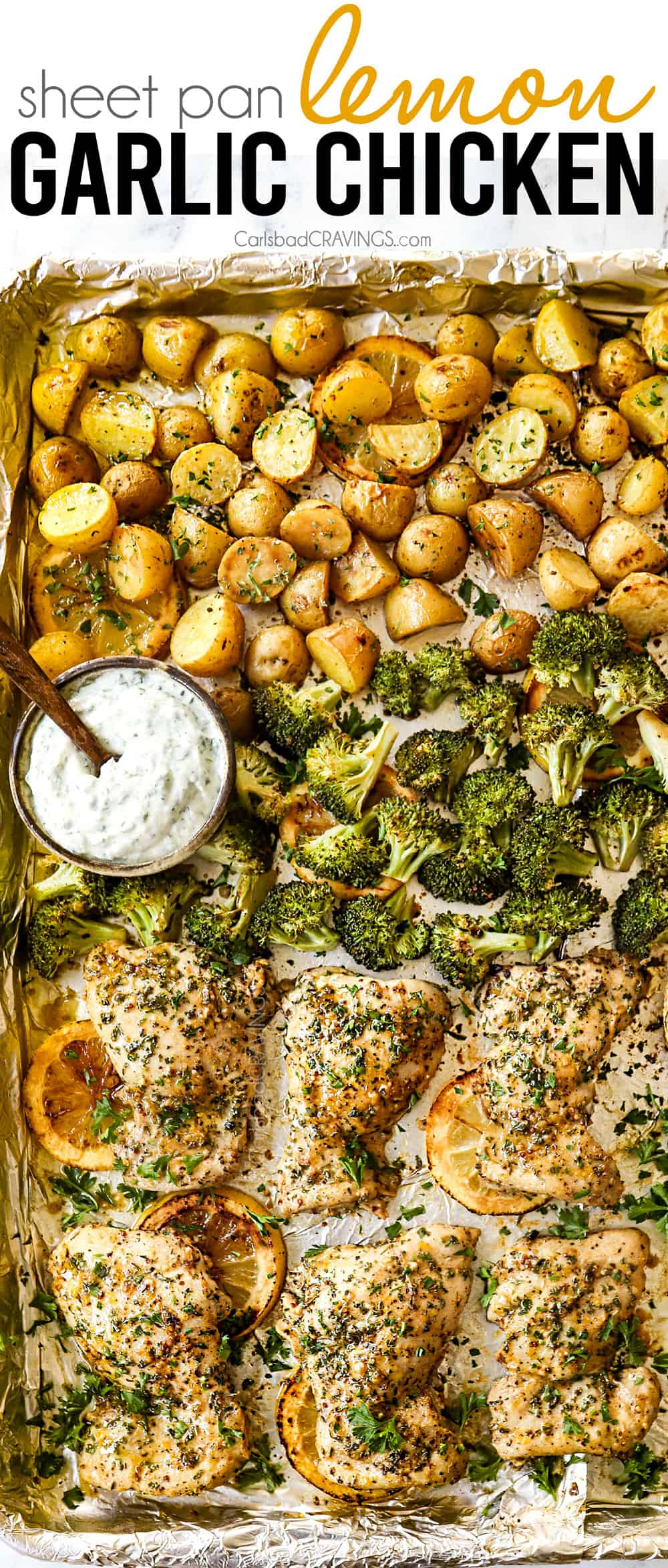 lemon garlic chicken thighs with broccoli and potatoes on a sheet pan baked in the oven