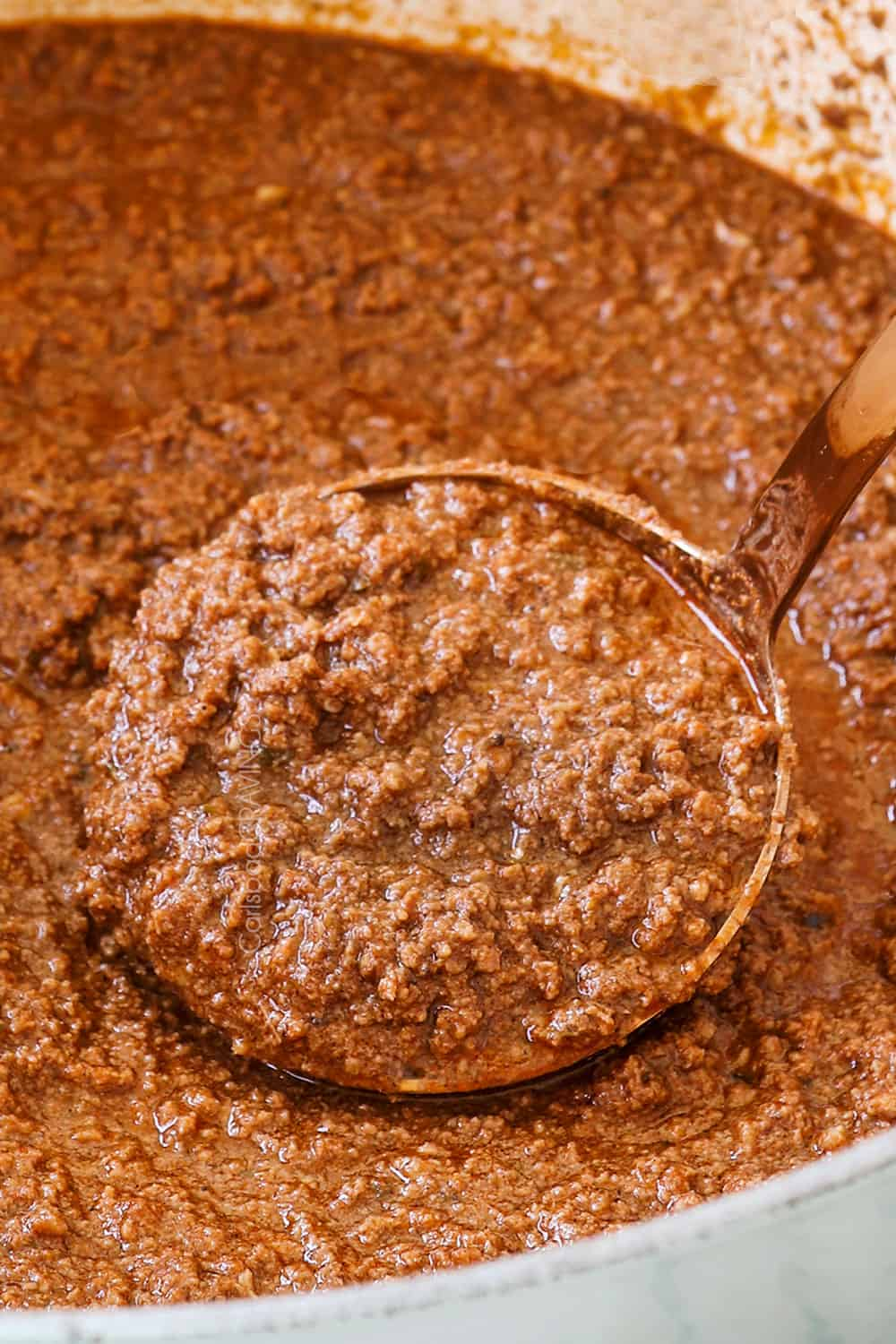 showing how to make Cincinnati Chili recipe by simmering until thickened