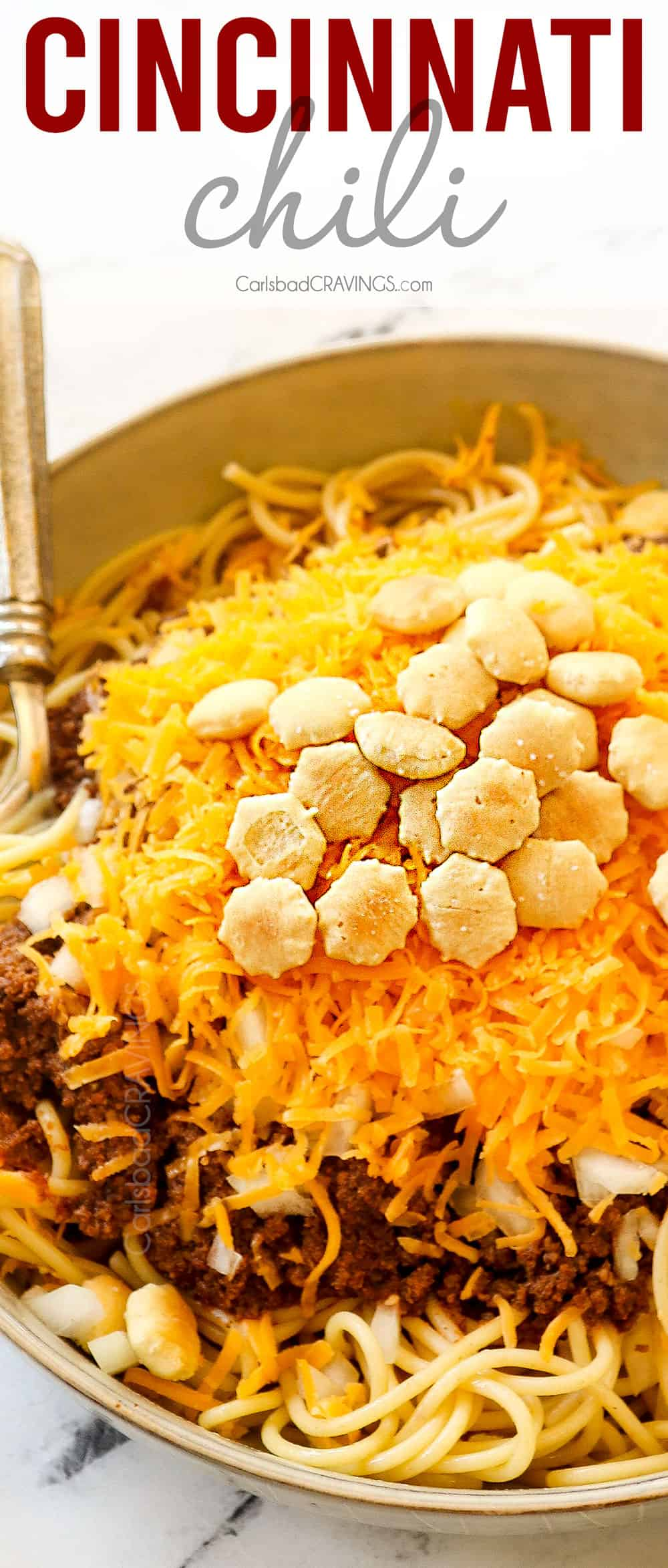 up close of skyline chili Cincinnati in a bowl with cheese, onions and oyster crackers