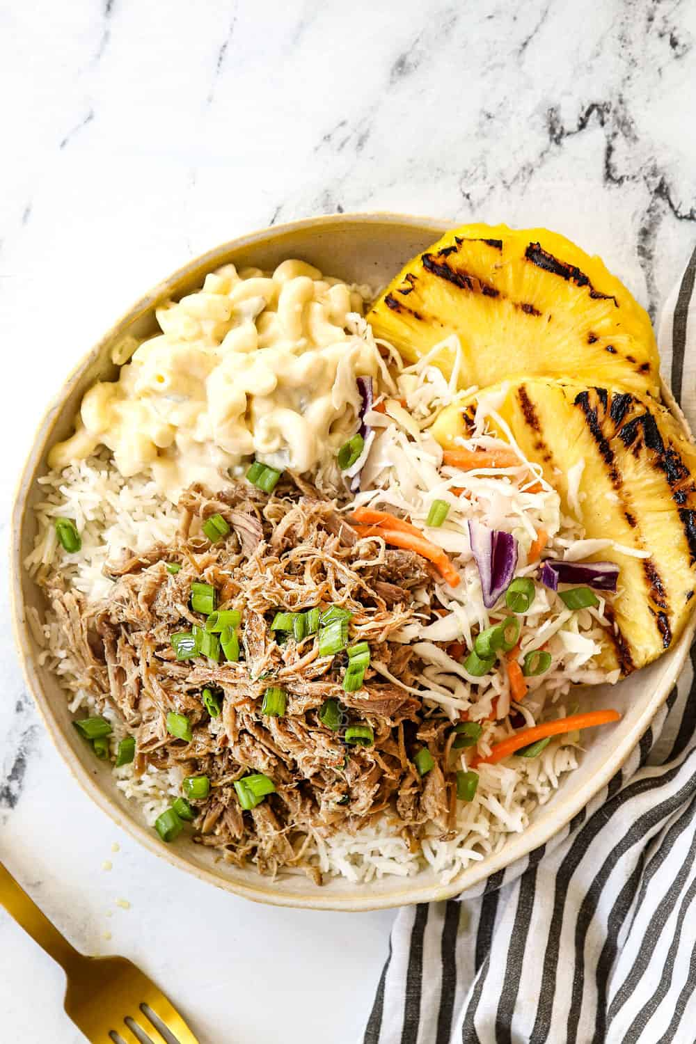 top view of a plate of Kalua Pork recipe with rice, pineapple and macaroni salad