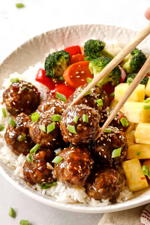 picking up teriyaki meatballs with chopstick
