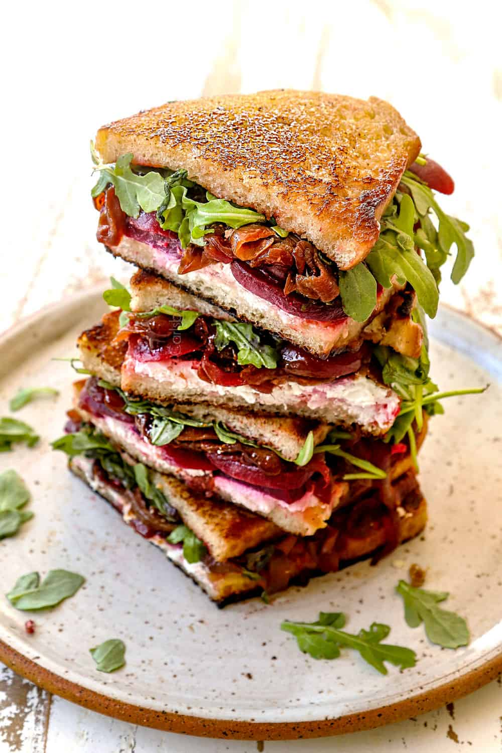 a stack of gourmet grilled cheese sandwiches