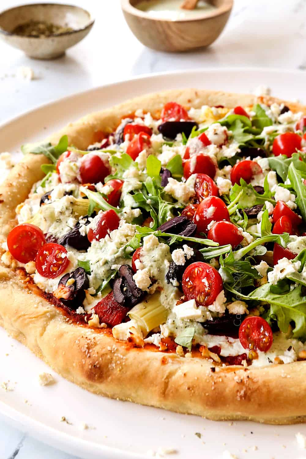 up close of Greek pizza showing how soft and chewy the crust is