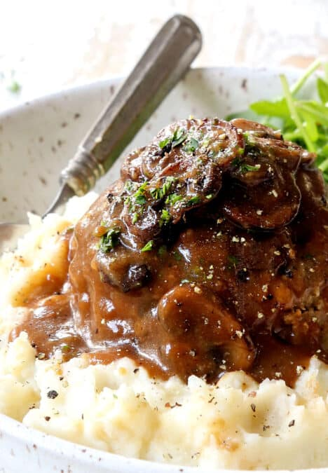up close of homemade Salisbury Steak on mashed potatoes